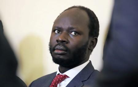 Peter Biar Ajak, the South Sudan country director for the London School of Economics International Growth Centre based in Britain, sits in the dock inside the courtroom in Juba