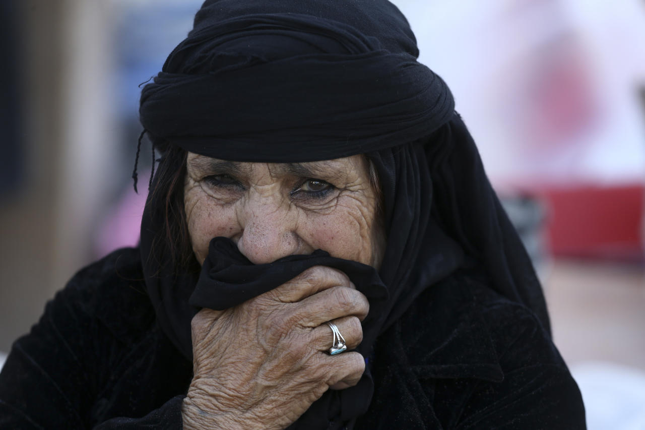 <p>An earthquake survivor weeps in front of her house in a compound which was built under the Mehr state-owned program, in Sarpol-e-Zahab in western Iran, Nov. 14, 2017.(Photo: Vahid Salemi/AP) </p>