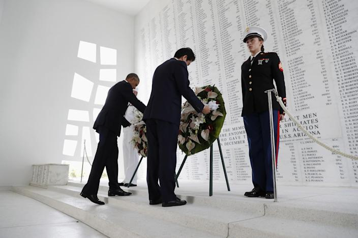 <p>DEC. 27, 2016 — President Barack Obama and Japanese Prime Minister Shinzo Abe participate in a wreath laying ceremony at the USS Arizona Memorial, part of the World War II Valor in the Pacific National Monument, in Joint Base Pearl Harbor-Hickam, Hawaii, adjacent to Honolulu, Hawaii as part of a ceremony to honor those killed in the Japanese attack on the naval harbor. (AP Photo/Carolyn Kaster) </p>