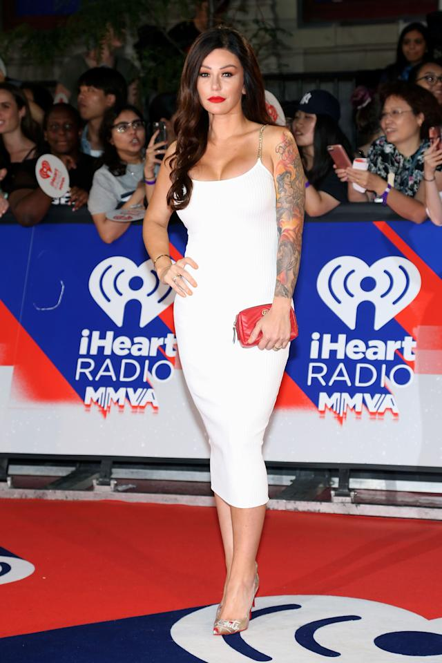 "<p>The ""Jersey Shore"" alum spiced up the red carpet in a curve-hugging white dress and sky high stiletto heels. Paired with a bold red lip and silky waves, Farley was on-hand to present alongside fellow reality TV veteran Kristin Cavallari. </p>"