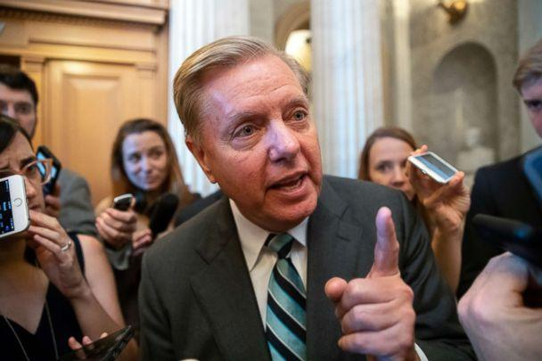 PHOTO: Sen. Lindsey Graham, a member of the Senate Judiciary Committee, makes a point to reporters about Brett Kavanaugh's accusers as he arrives for a vote at the Capitol in Washington, Sept. 26, 2018. (J. Scott Applewhite/AP)