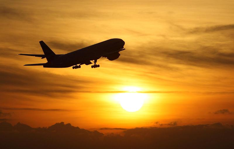 File photo dated 19/11/08 of a plane taking off at sunset. More UK holidaymakers are choosing non-European Union countries for their summer holiday this year, new figures suggest.