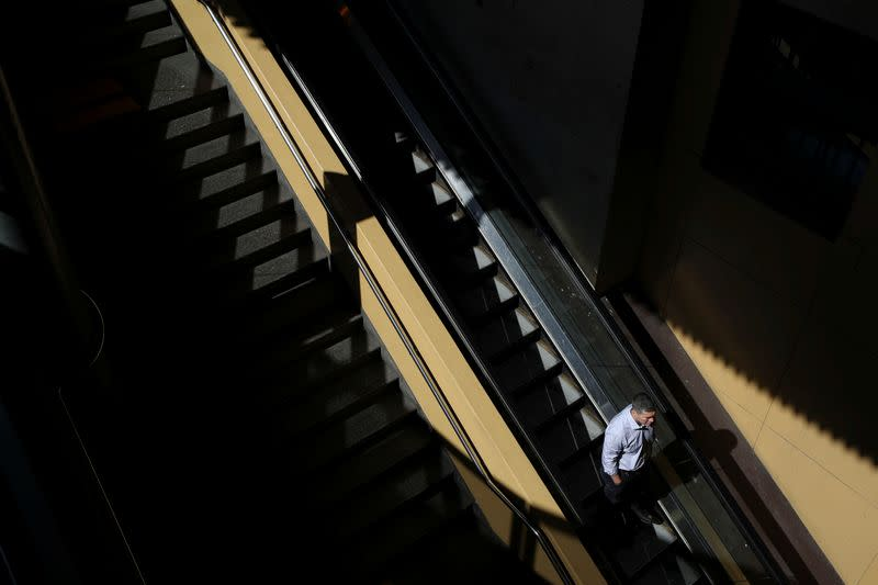 A man uses an escalator at Sydney Central railway station during a workday following the implementation of stricter social-distancing and self-isolation rules to limit the spread of the coronavirus disease (COVID-19) in Sydney