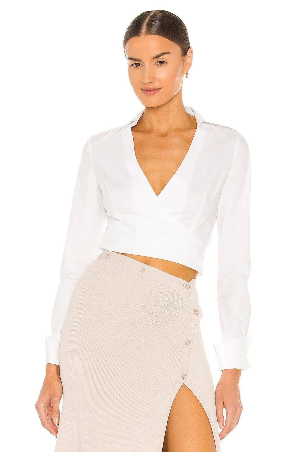 <p>This <span>Aya Muse Aya Wrap Shirt</span> ($196, originally $280) is sophisticated and flirty. It looks great with a high waisted skirt.</p>