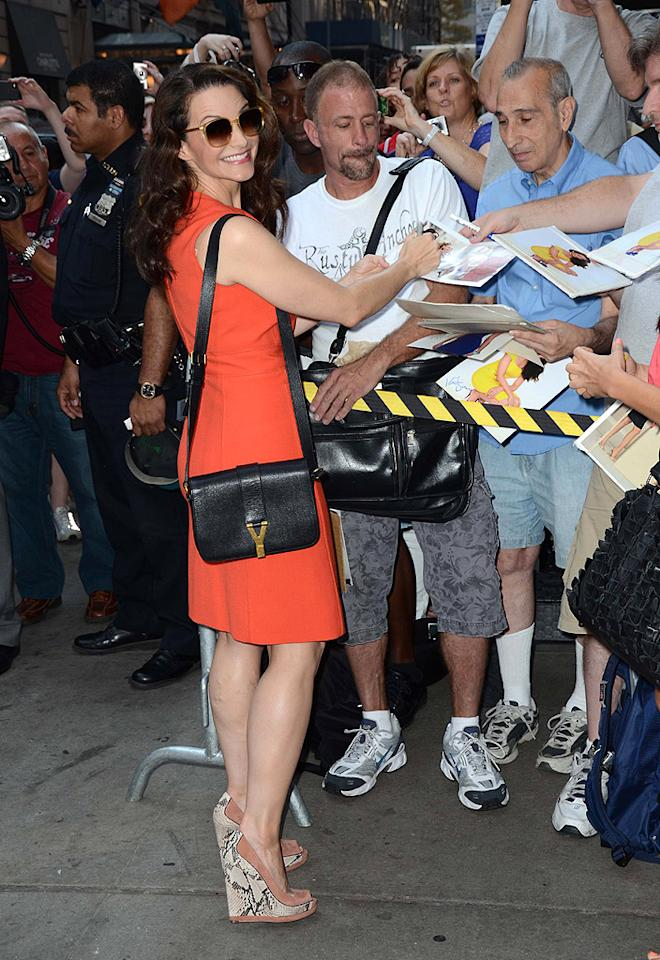 """Sex and the City"" star Kristin Davis mingled with fans outside the show and looked more than happy to sign a few autographs while donning a tangerine Tori Burch frock and snakeskin platform wedges. She's currently appearing in the Broadway version of Gore Vidal's ""The Best Man."""