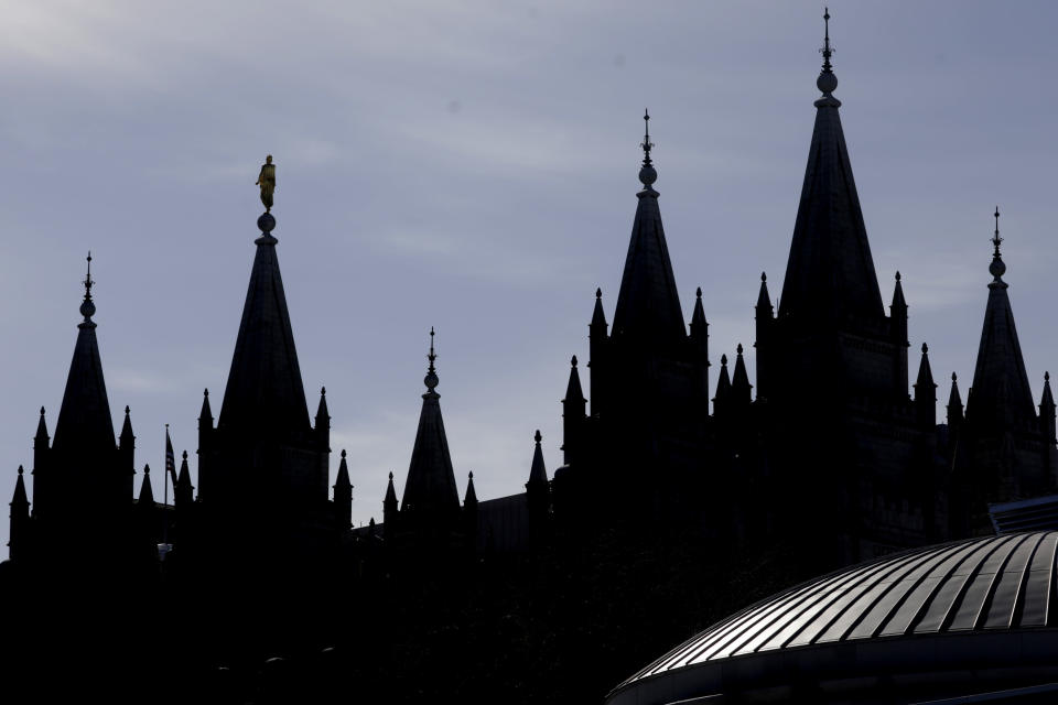 FILE - In this April 4, 2020, file photo, is The Salt Lake Temple of The Church of Jesus Christ of Latter-day Saints in Salt Lake City. The Church of Jesus Christ of Latter-day Saints has announced that face masks will be required inside temples to limit the spread of COVID-19. Church leaders said Wednesday, Sept. 22, 2021, that masks will be required temporarily in an effort to keep temples open. (AP Photo/Rick Bowmer, File)