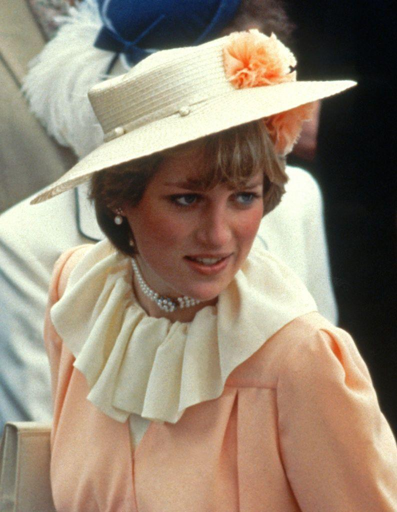 <p>This peach dress with a dramatic wide ruffle neckline and a straw boater hat was Diana's choice for the Royal Ascot in 1981.</p>