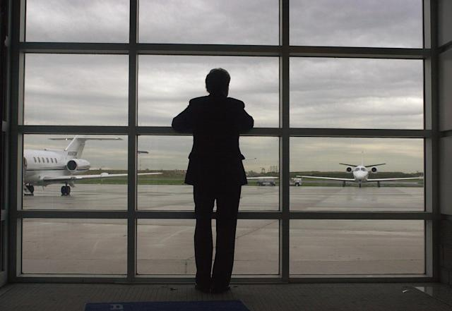 <p>Sen. Arlen Specter, R-Pa., looks out toward the tarmac at the executive terminal of Philadelphia International Airport as he waits to board a plane while campaigning one day before Pennsylvania's Republican primary on April 26, 2004. (Photo: Jacqueline Larma/AP) </p>