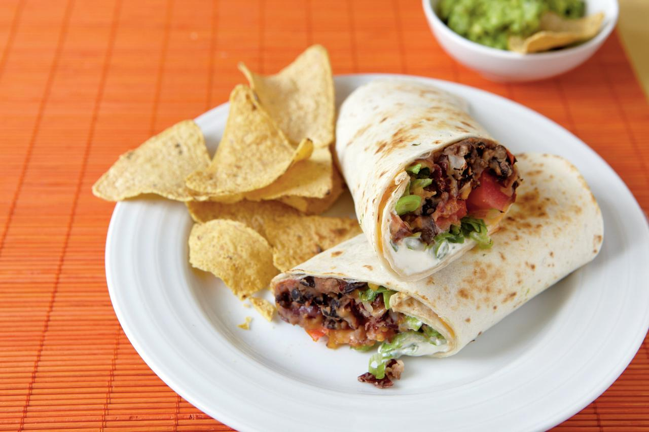 "<p>Add guacamole and chips to this hearty vegetarian dish for an easy Mexican meal.</p> <p> <a href=""http://www.myrecipes.com/recipe/chipotle-bean-burritos-0"">View Recipe: Chipotle Bean Burritos</a></p>"