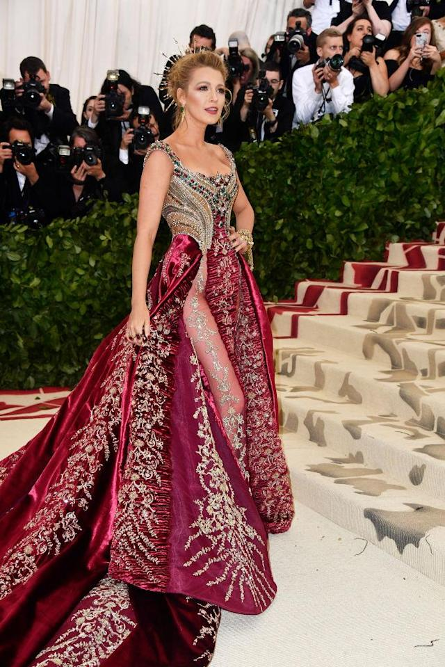 "<p>Lively looked like a queen in <span>Atelier Versace, before making an <a href=""https://www.yahoo.com/lifestyle/met-gala-2018-celebs-wore-slideshow-wp-152225986.html"" data-ylk=""slk:after party outfit change;outcm:mb_qualified_link;_E:mb_qualified_link"" class=""link rapid-noclick-resp newsroom-embed-article"">after party outfit change</a></span>. (Photo: Getty Images) </p>"