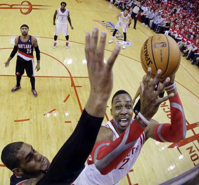 Portland Trail Blazers' LaMarcus Aldridge blocks a shot by Houston Rockets' Dwight Howard during the first half in Game 1 of an opening-round NBA basketball playoff series, Sunday, April 20, 2014, in Houston. (AP Photo/David J. Phillip)