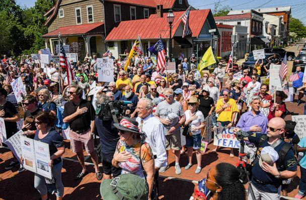 PHOTO: A group called 'Reopen Maryland' say the pledge of allegiance as they gather to protest the restrictions imposed by Maryland Governor Larry Hogan to combat the spread of the novel coronavirus. (Jonathan Newton/The Washington Post via Getty Images)