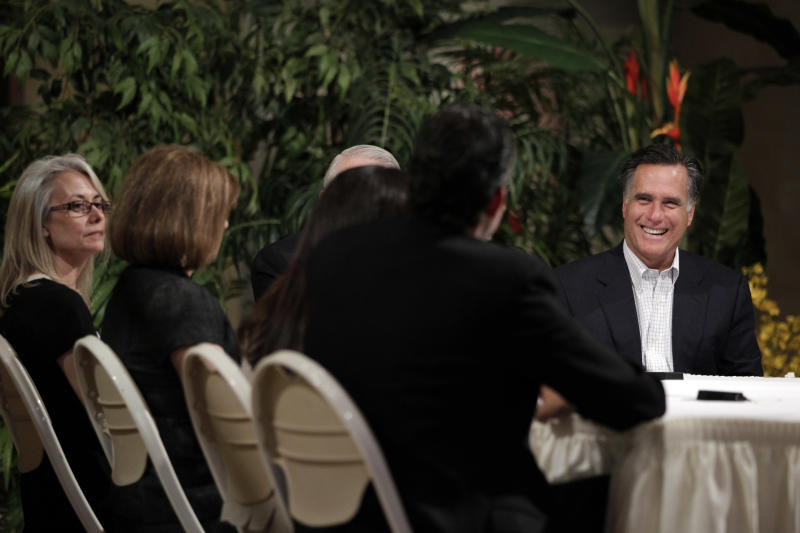 Republican presidential candidate, former Massachusetts Gov. Mitt Romney, right, holds a roundtable discussion with Hispanic business owners in Tempe, Ariz., Friday, April 20, 2012. (AP Photo/Jae C. Hong)