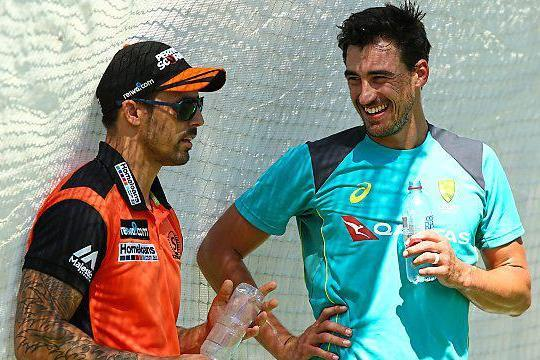 Plan of attack | Mitchell Johnson, England's nemesis four years ago, chats to new Aussie pace hero Mitchell Starc at practice in Perth this morning: Paul Kane/Getty Images