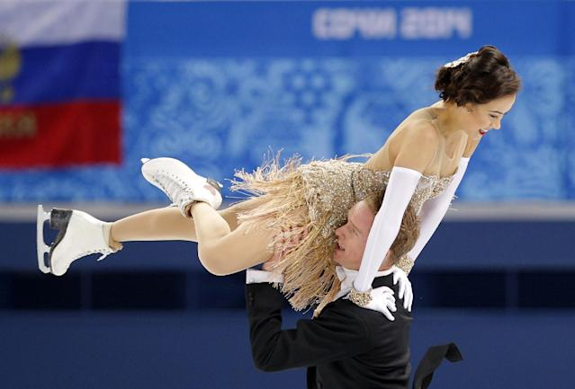 Madison Chock and Evan Bates of the United States compete in the ice dance short dance figure skating competition at the Iceberg Skating Palace during the 2014 Winter Olympics, Sunday, Feb. 16, 2014, in Sochi, Russia. (AP Photo/Vadim Ghirda)