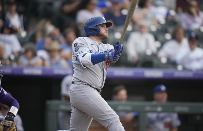 Los Angeles Dodgers' Max Muncy follows the flight of his two-run home run off Colorado Rockies relief pitcher Lucas Gilbreath in the 10th inning of a baseball game Thursday, Sept. 23, 2021, in Denver. (AP Photo/David Zalubowski)