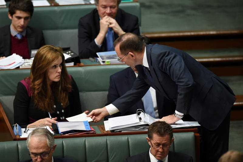 Tony Abbott speaks to his chief of staff, Peta Credlin (left), at Parliament House in 2015.