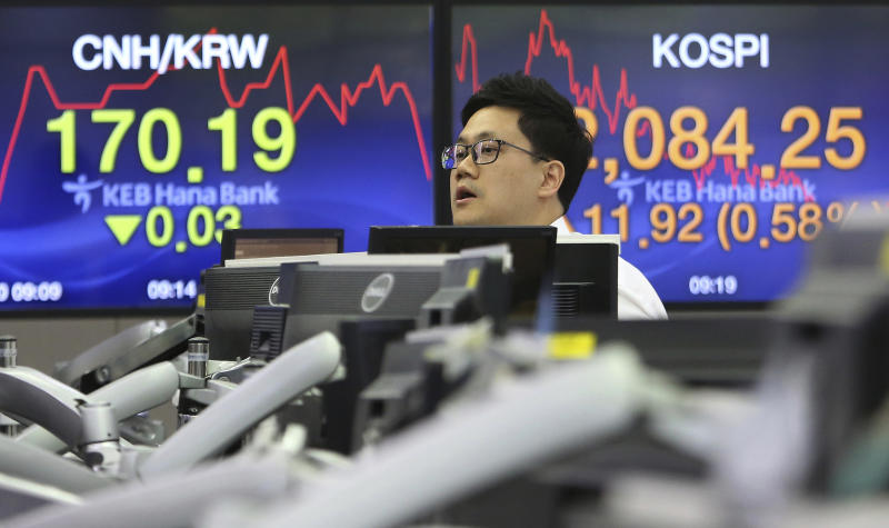 A currency trader works at the foreign exchange dealing room of the KEB Hana Bank headquarters in Seoul, South Korea, Monday, June 10, 2019. Asian financial markets advanced on Monday after China released better-than-expected trade data for May. Gains were reined in by worries over where the world's two largest economies stood on trade negotiations. (AP Photo/Ahn Young-joon)