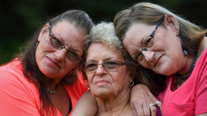 8/28/19 7:11:42 PM -- Clarksburg, WV, U.S.A  -- Mary Shaw, left and Linda Shaw, right, with their mother Norma Shaw, who was married to  Air Force veteran George Nelson Shaw Sr., who died on on April 10, 2018, at the VA hospital in Clarksburg, W. Va. His death, ruled a homicide by an Armed Forces examiner, is one of 10 under investigation by federal authorities. He was 81.     --    Photo by Jack Gruber, USA TODAY staff