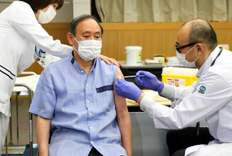 Japan's Prime Minister Yoshihide Suga received his vaccine on Tuesday