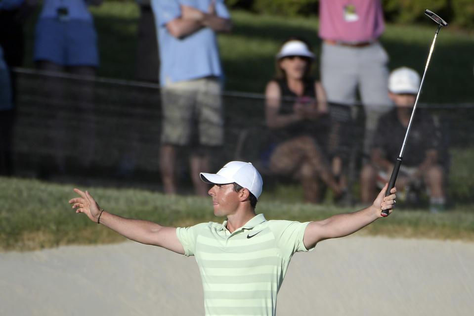 Rory McIlroy, of Northern Ireland, celebrates after making a birdie on the 18th green during the final round of the Arnold Palmer Invitational golf tournament Sunday, March 18, 2018, in Orlando, Fla. McIlroy won the tournament at 18-under-par. (AP Photo/Phelan M. Ebenhack)