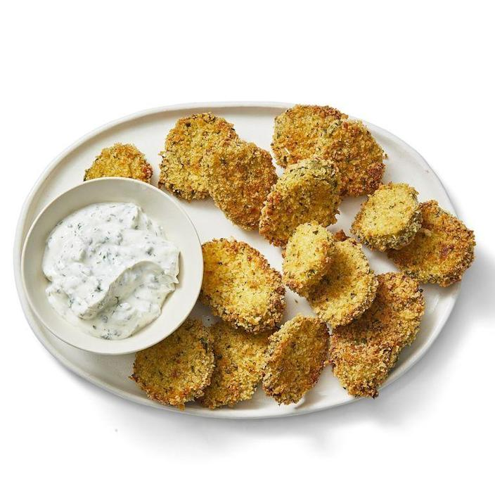"""<p>Pickles may not be everyone's cup of tea, but if they're yours and your guests', then you're definitely going to want to try these. Plus, they're baked, not fried, which makes them a lighter snack option. <br></p><p><em><a href=""""https://www.womansday.com/food-recipes/a30393766/crispy-ranch-pickles-recipe/"""" rel=""""nofollow noopener"""" target=""""_blank"""" data-ylk=""""slk:Get the Crispy Ranch Pickles recipe."""" class=""""link rapid-noclick-resp"""">Get the Crispy Ranch Pickles recipe.</a></em></p>"""