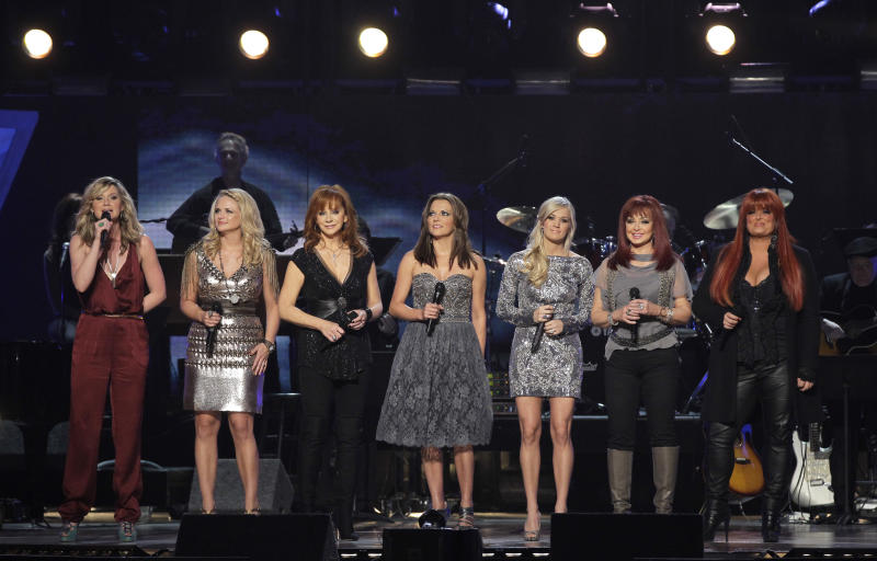 From left, Jennifer Nettles, Miranda Lambert, Reba McEntire, Martina McBride, Carrie Underwood, Naomi Judd and Wynonna Judd are seen onstage at the Girls Night Out: Superstar Women of Country in Las Vegas on Monday, April 4, 2011. (AP Photo/Julie Jacobson)