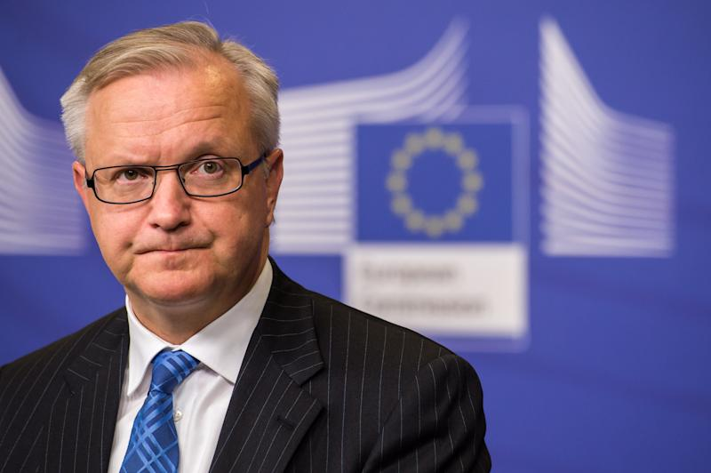 EU Commissioner for economic and monetary affairs Olli Rehn addresses the media on the economic situation in Spain at the European Commission headquarters in Brussels, Wednesday Nov. 14, 2012. (AP Photo/Geert Vanden Wijngaert)