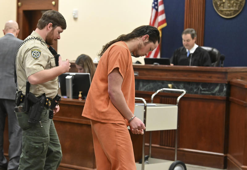 Jacob Kaderli is escorted out after Judge Jack Niedrach denied a bond at Floyd County Superior Court in Rome, Ga., on Friday, Feb. 14, 2020. Bond was denied Friday for two Georgia men, 19-year-old Kaderli of Dacula and 25-year-old Michael Helterbrand of Dalton, authorities say are linked to a violent white supremacist group known as The Base. (Hyosub Shin/Atlanta Journal-Constitution via AP)