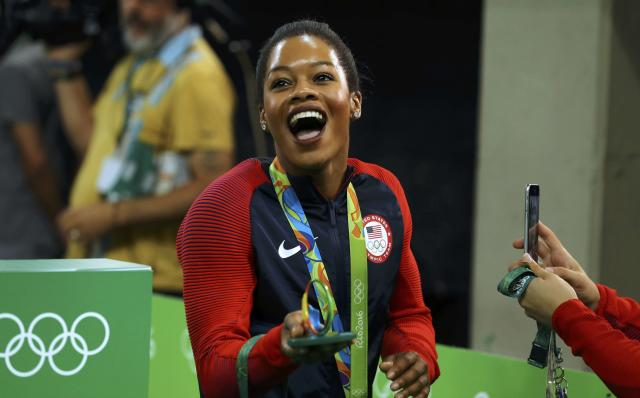 2016 Rio Olympics - Artistic Gymnastics - Victory Ceremony - Women's Team Victory Ceremony - Rio Olympic Arena - Rio de Janeiro, Brazil - 09/08/2016. Gabrielle Douglas (USA) of the U.S. leaves after winning gold at the victory ceremony for the women's team final. REUTERS/Mike Blake FOR EDITORIAL USE ONLY. NOT FOR SALE FOR MARKETING OR ADVERTISING CAMPAIGNS.