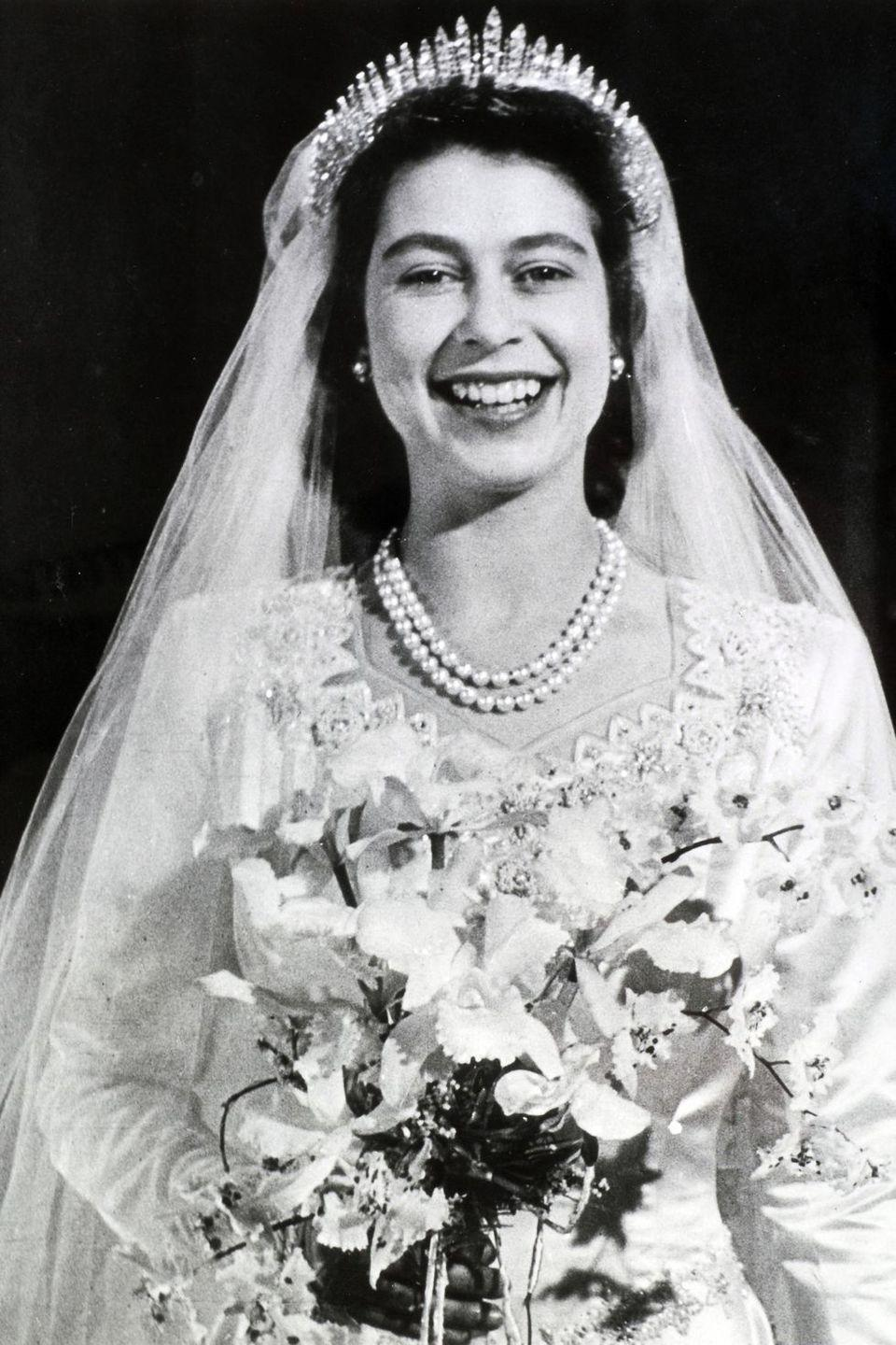 "<p><strong>Wedding date: </strong>November 20, 1947</p><p><strong>Wedding tiara: </strong>Queen Elizabeth wore Queen Mary's Russian Fringe tiara on her wedding day. The piece of jewelry was made for Queen Mary, the grandmother of Queen Elizabeth, in 1919 and can be worn as a necklace or atop the head. <a href=""https://www.townandcountrymag.com/leisure/arts-and-culture/news/a8451/queen-elizabeth-prince-philip-wedding/"" rel=""nofollow noopener"" target=""_blank"" data-ylk=""slk:Elizabeth's tiara famously broke on her wedding day,"" class=""link rapid-noclick-resp"">Elizabeth's tiara famously broke on her wedding day,</a> but was quickly repaired. </p>"
