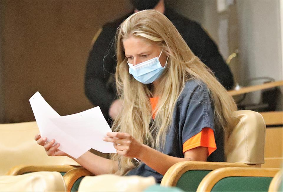 Arson suspect Alexandra Souverneva looks over papers during her appearance in Shasta County Superior Court on Friday afternoon, Sept. 24, 2021.