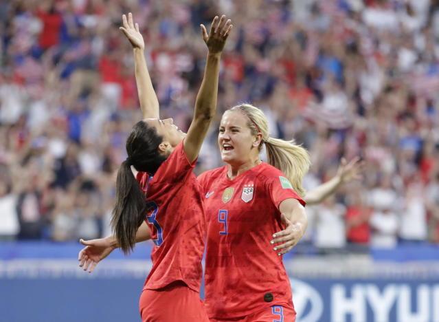Christen Press, left, celebrates with United States' Lindsey Horan after scoring her side's first goal during the Women's World Cup semifinal soccer match between England and the United States. (AP)
