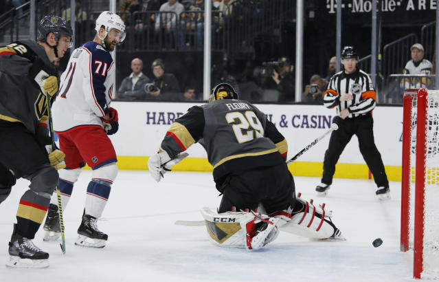 Columbus Blue Jackets left wing Nick Foligno (71) watches a goal by teammate Emil Bemstrom, not pictured, get past Vegas Golden Knights goaltender Marc-Andre Fleury during the first period of an NHL hockey game Saturday, Jan. 11, 2020, in Las Vegas. (AP Photo/John Locher)