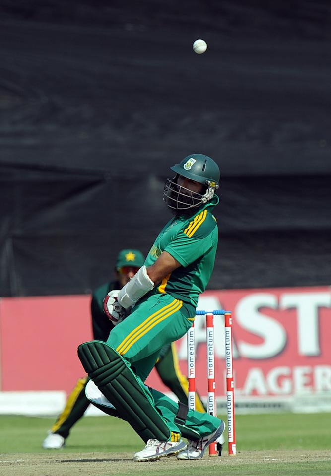 South Africa's cricketer Hashim Amla avoids a bouncer during the 5th and final One-Day Internationals (ODI) cricket match between South Africa and Pakistan at Willowmoore Park in Benoni on  March 24, 2013.           AFP PHOTO / ALEXANDER JOE        (Photo credit should read ALEXANDER JOE/AFP/Getty Images)