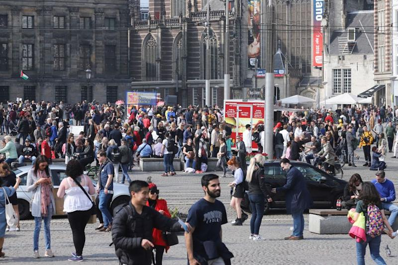 Tourists have flooded Amsterdam—including the city's Dam Square—and the Netherlands is now looking to push tourists towards other, less crowded destinations. ( | NurPhoto via Getty Images.)