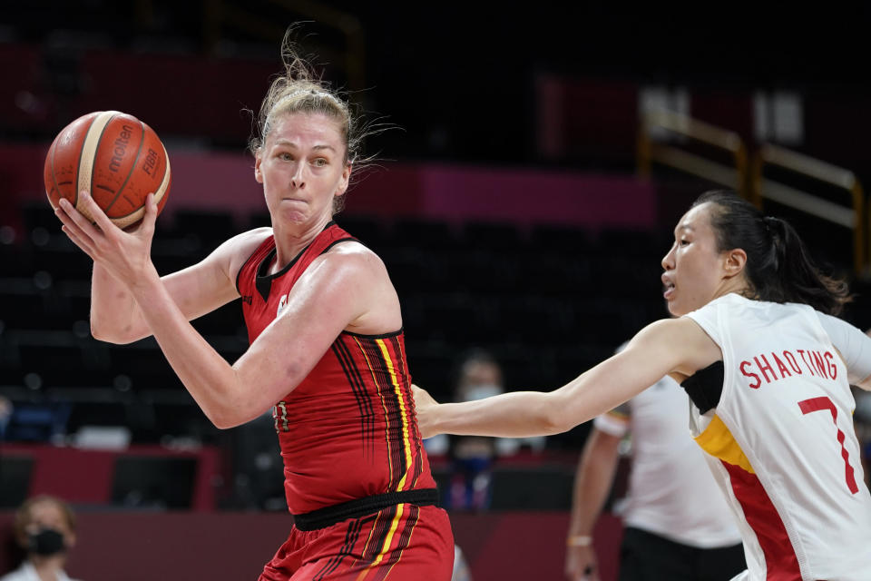 Belgium's Emma Meesseman drives to the basket past China's Ting Shao (7) during a women's basketball preliminary round game at the 2020 Summer Olympics, Monday, Aug. 2, 2021, in Saitama, Japan. (AP Photo/Charlie Neibergall)