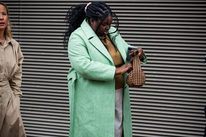 <p>A minty overcoat makes this whole look sing. </p>