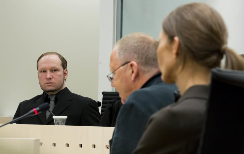Psychiatrists team no 1. Torgeir Husby, center, and Synne Soerheim, right defend their report during the trial of Anders Behring Breivik, left, who last year shot 69 people and killed eight in a bomb attack, in the Oslo courthouse Thursday June 14, 2012. Teams have reached opposite conclusions about the 33-year-old's mental state, a central issue in his trial. The trial is scheduled to conclude June 22. (AP Photo/Heiko Junge/NTB scanpix, Pool)