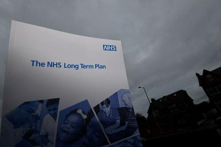 FILE PHOTO: Britain's Prime Minister Theresa May launches the government's The NHS Long Term Plan
