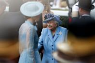<p>Kate's blue outfit ended up matching the palate of the Queen's outfit, who also went for blue that day. The two women could both rewear this 2019 look. (Adrian Dennis/AFP)</p>