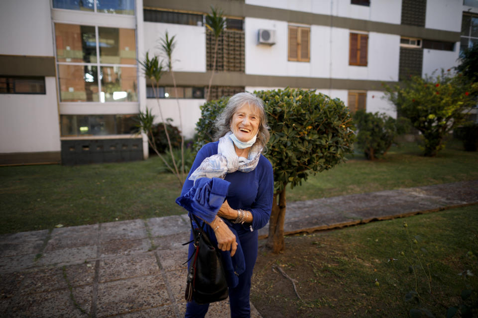 Carmela Corleto arrives home from a vaccination center where she got her first shot of the AstraZeneca vaccine for COVID-19 in Burzaco, Argentina, Friday, April 23, 2021. (AP Photo/Natacha Pisarenko)