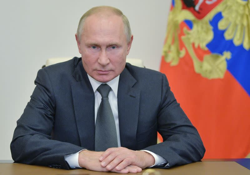 Russian President Putin meets with Chief of the Russian Armed Forces' General Staff Gerasimov via a video conference call, outside Moscow