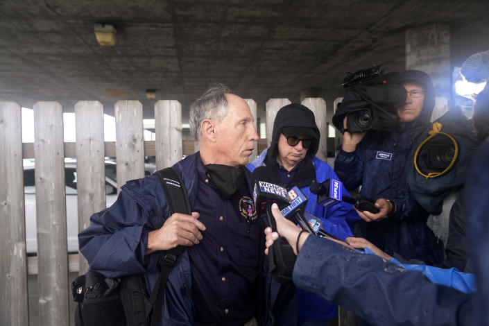 Bruce Landsberg, vice chairman of the NTSB, talks to reporters as he leaves a briefing for family members by Coast Guard and NTSB officials in Port Fouchon, La., Friday, April 16, 2021. The Coast Guard has told families of missing workers that another body has been found from the lift boat capsized off the Louisiana coast and a coroner has confirmed that to a news outlet. (AP Photo/Gerald Herbert)