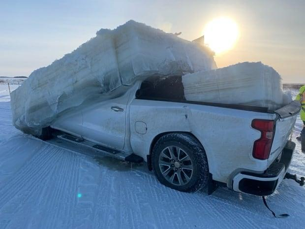 The truck was removed from the Des Rochers River near Fort Chipewyan, Alta., along with a few tons of ice. (Submitted by Ray Rossington - image credit)