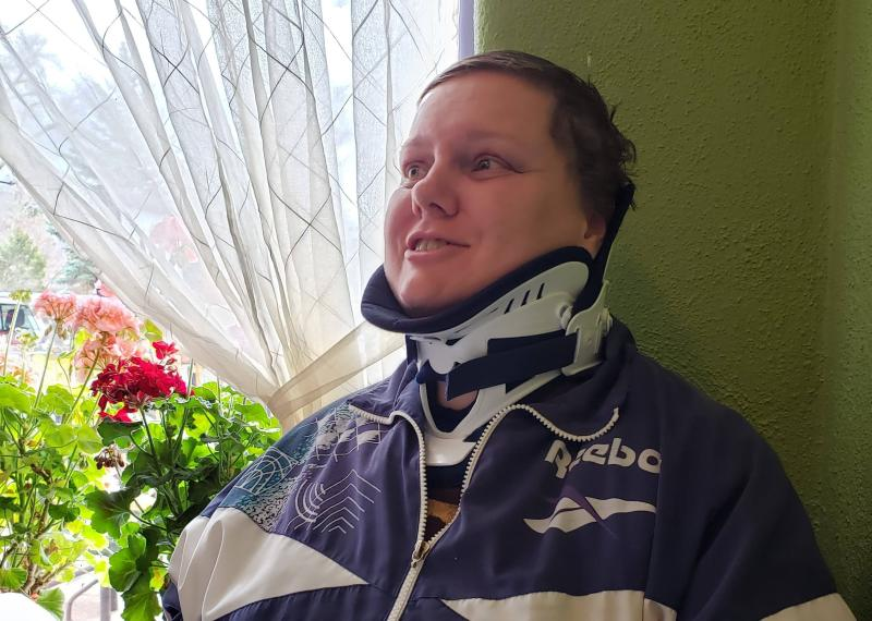 Hunt wearing a brace to stabilize her neck after suffering a C7 transverse process fracture in her back and several torn ligaments in the avalanche.