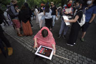 A protester prepares a banner prior to a solidarity rally for the death of George Floyd in Tokyo Sunday, June 14, 2020. Floyd died after being restrained by Minneapolis police officers on May 25. (AP Photo/Eugene Hoshiko)