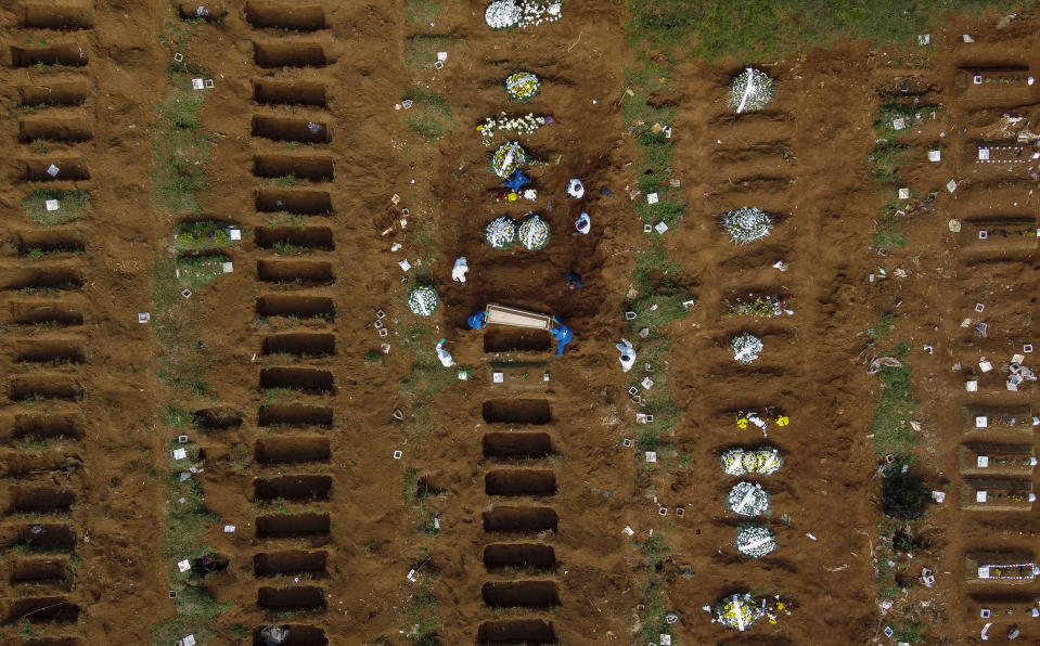 SAO PAULO, BRAZIL - April 1: An aerial view of Vila Formosa cemetery during a burial amidst the coronavirus (COVID-19) pandemic. (Photo by Miguel Schincariol/Getty Images)