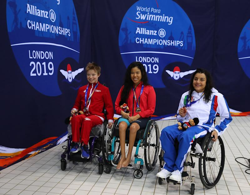 LONDON, ENGLAND - SEPTEMBER 11: Pin Xiu Yip (gold) Aly van Wyck-Smart (silver) of Canada and Angela Procida of Italy (bronze) after the Women's 100m Backstroke S2 Final on Day Three of the London 2019 World Para-swimming Allianz Championships at Aquatics Centre on September 11, 2019 in London, England. (Photo by Catherine Ivill/Getty Images)