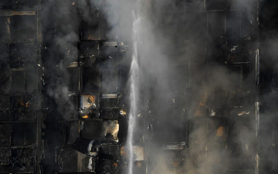 Firefighters try to tackle the fire - Credit: Reuters